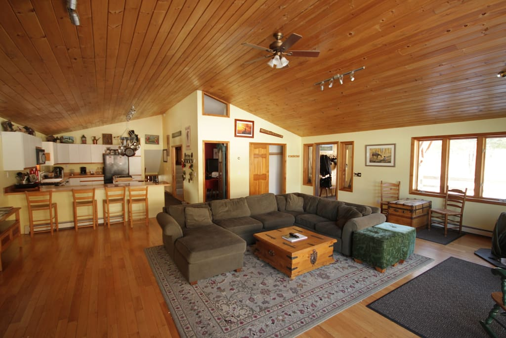 Our cathedral ceiling great room with views of the ski trails and our horses.