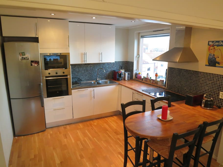 The kitchen with bar stools.