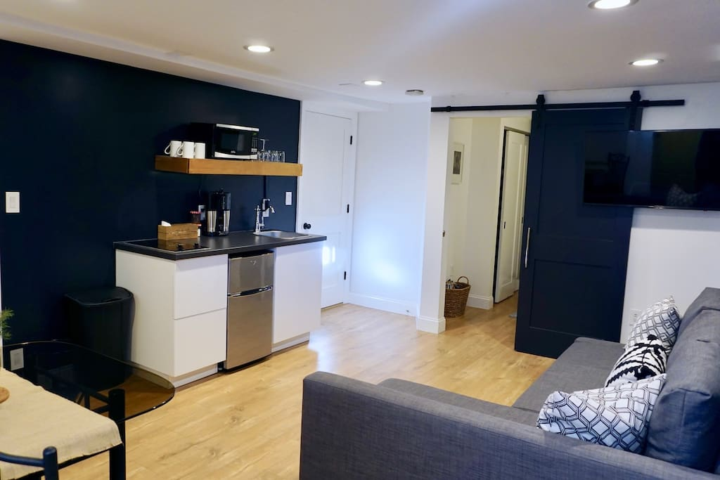 Spacious living/lounge area that includes light dimmer and usb outlets throughout
