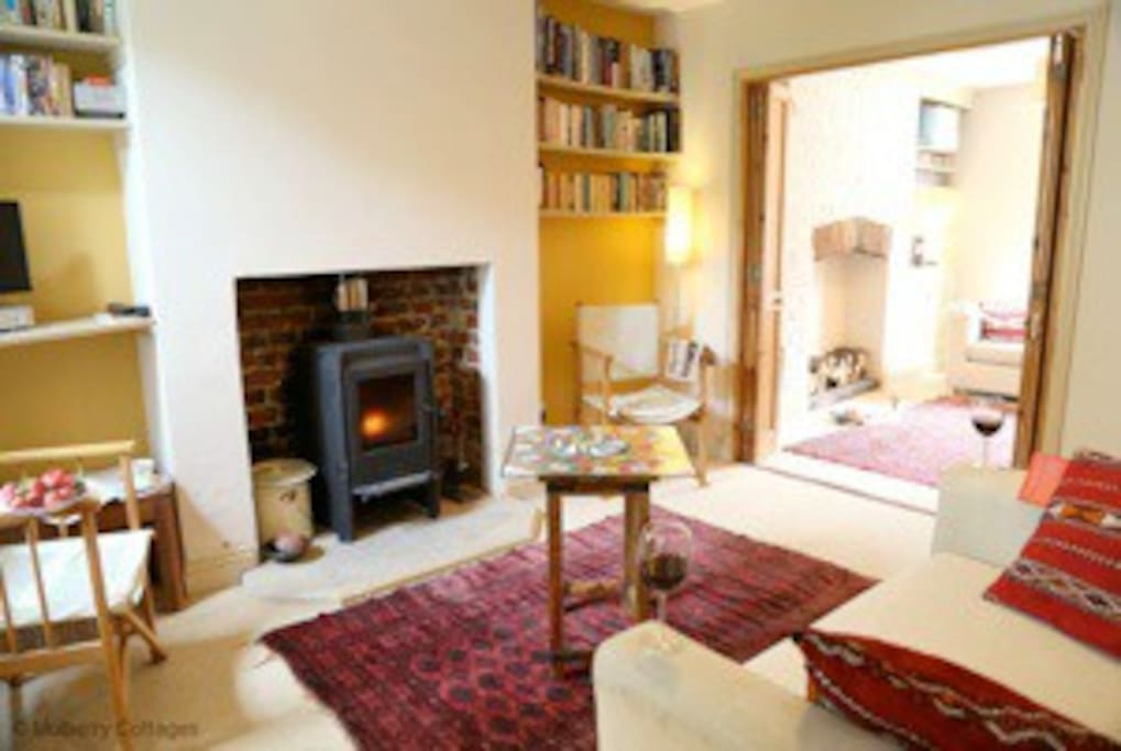 The double sitting room with wood burning stove