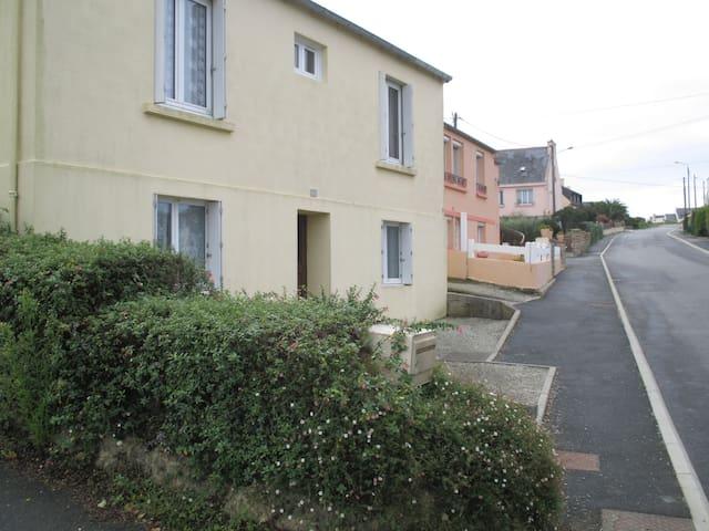 Appartement dans maison rez de chaussée