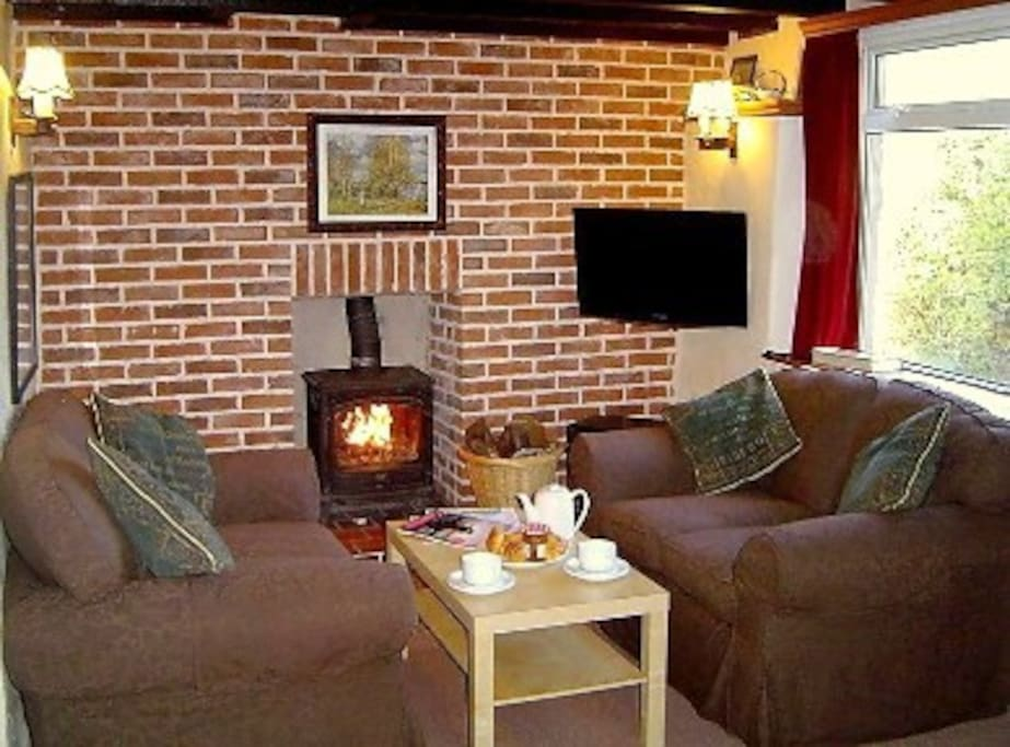 Our comfy lounge with wood fire and tea or coffee ready to pour.