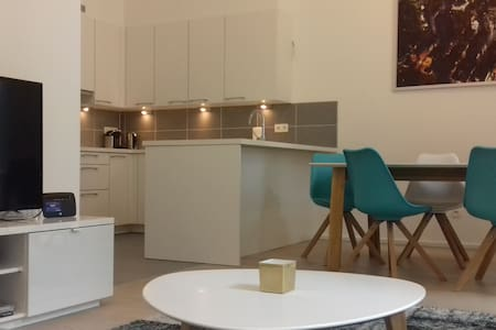 Stylish new apartment- Grand Place - with Parking