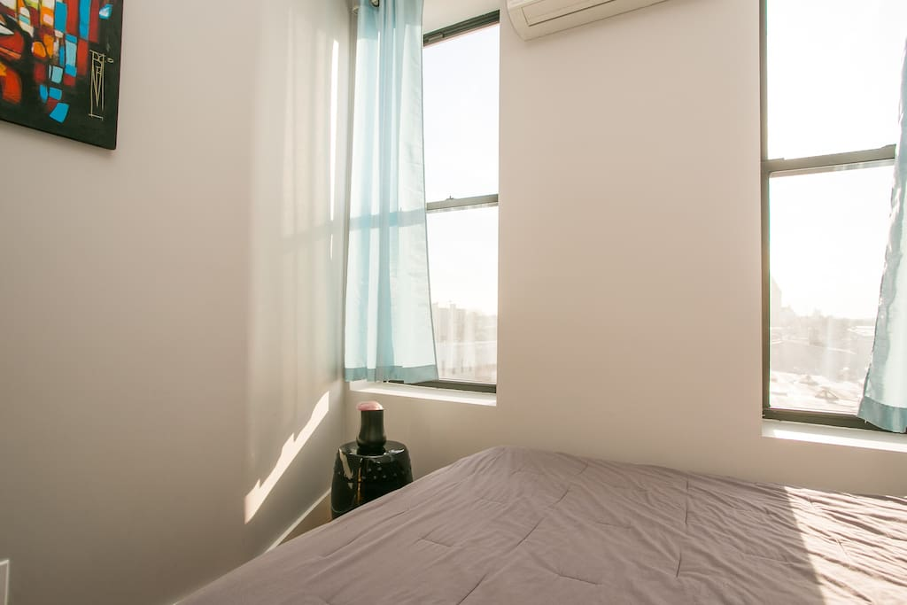 Sunny bedroom with a view of the train from west-facing windows.