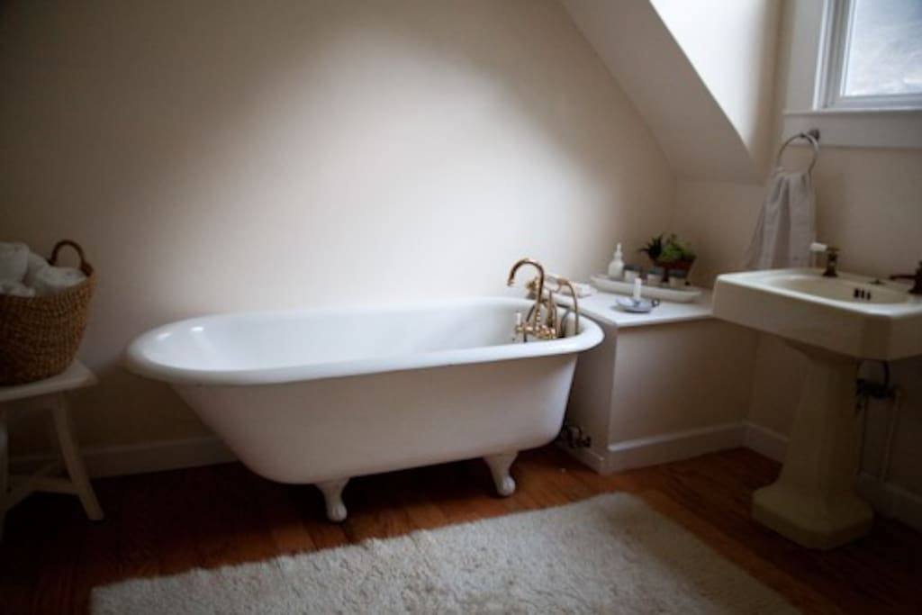 large bathroom with claw foot bathtub
