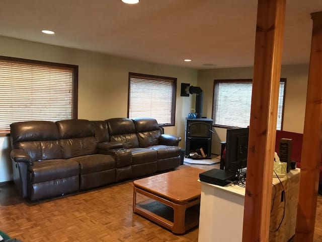 Living room has couch with 4 reclining seats, futon and wood stove.    Laundry on first floor.