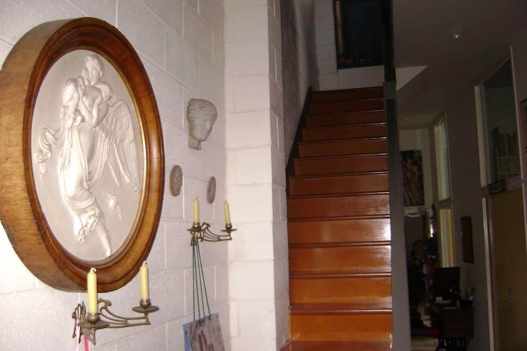 The entrance & upstairs to living area