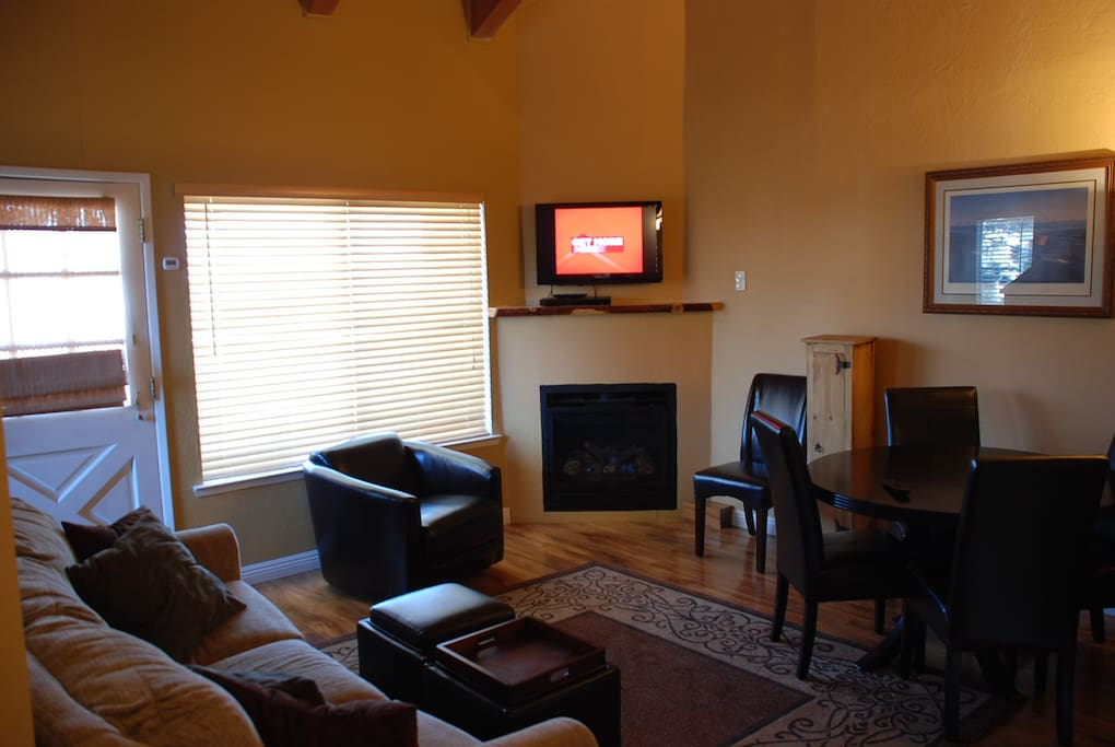 Cozy family room centered on cozy gas fireplace and flat screen tv w DVD.