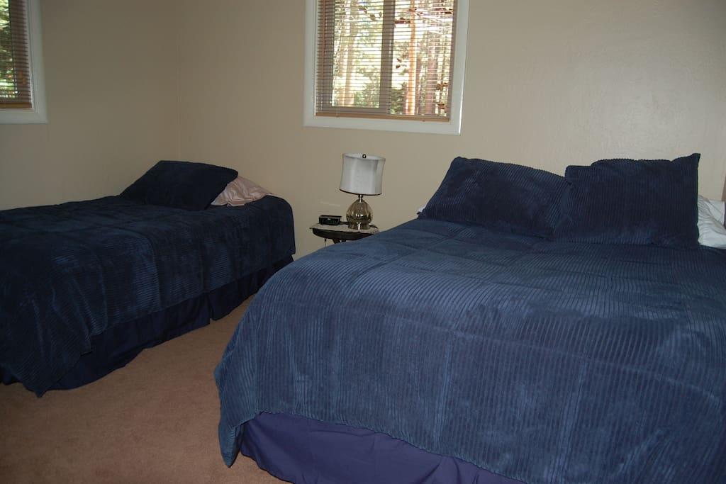Bedroom with twin and double bed.