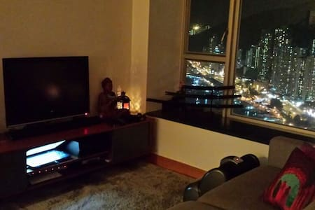 We live in an estate on the south side of Hong Kong Island, called Sham Wan Towers. We have a 2 bedroom apartment which is fully furnished. It has a beautiful view of Aberdeen harbour and has local attractions just a few minutes by foot. :)