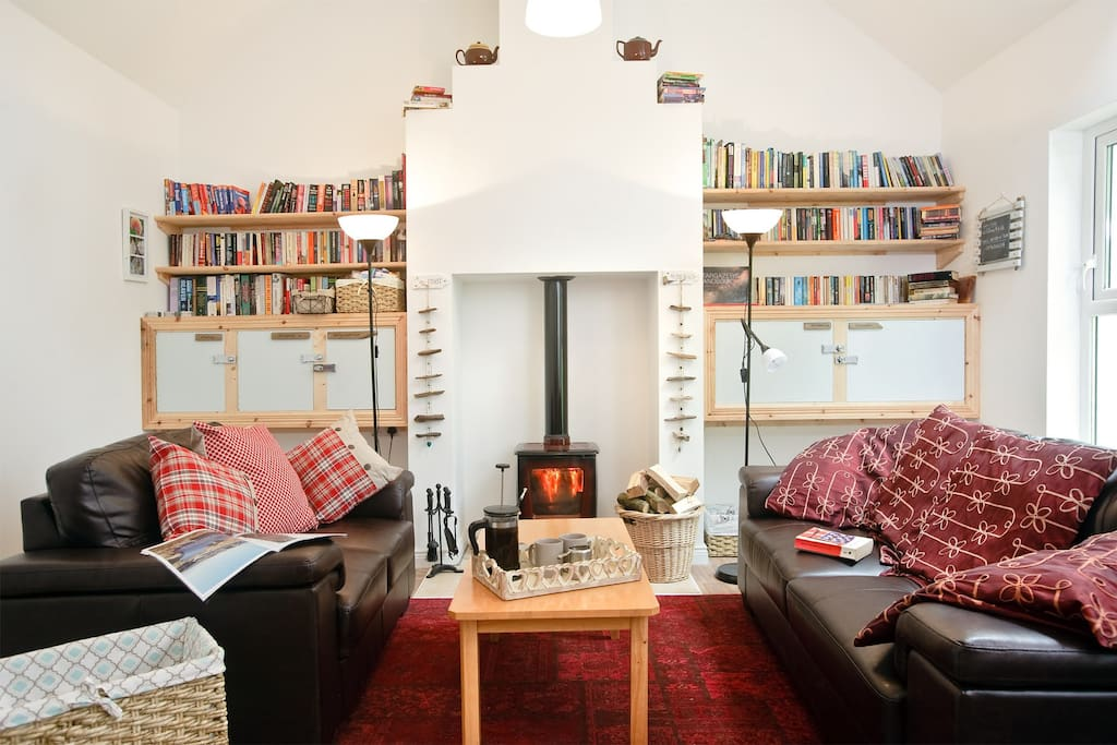 This is our lounge area available for guests to use. Wood burning stove sofas, library, wifi