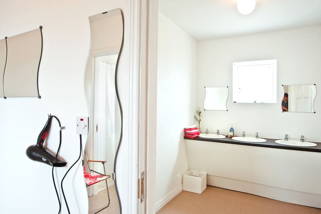Clean and spacious bathroom facilities including hot showers, mirrors, hairdryers, shaving points.