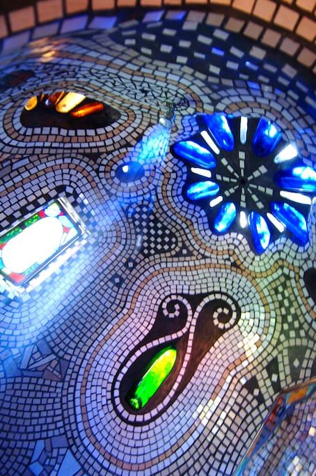 Gaudi-esque mosaic shower.