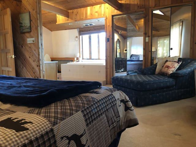 Views in the 2nd Master Bedroom, nice views from the soaker tub, heated bathroom, knotty pine... Large closets.