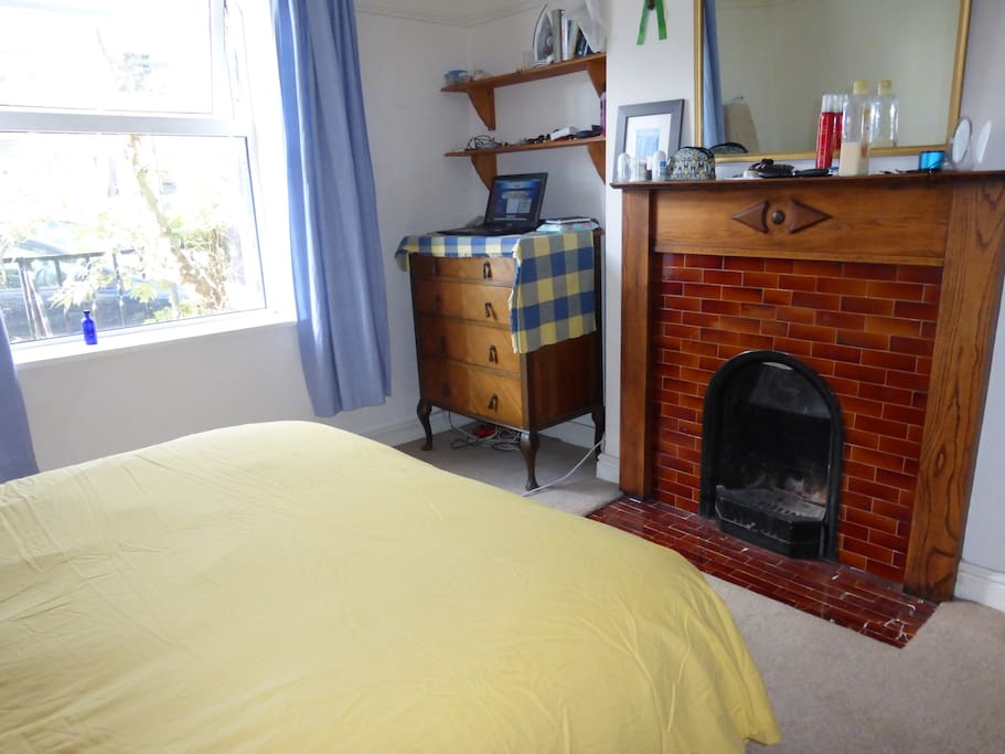 double bedroom with original 1850's fireplace and double futon bed