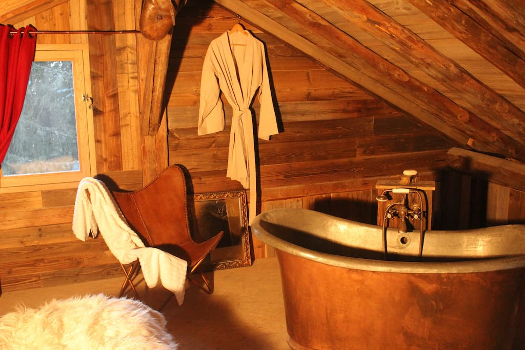 gorgeous antique copper bath, snug to the eaves in this mountain retreat.