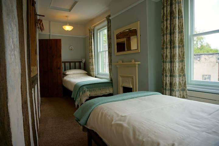The second bedroom is traditionally styled