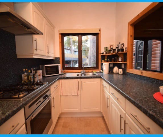 Well equipped galley kitchen with fridge/freezer, microwave, gas hob, electric oven & grill, pots, pans, slow cooker, kettle, toaster, dishwasher, crockery, cutlery, glass ware  and kitchen utensils. Washer/dryer located in our shed.