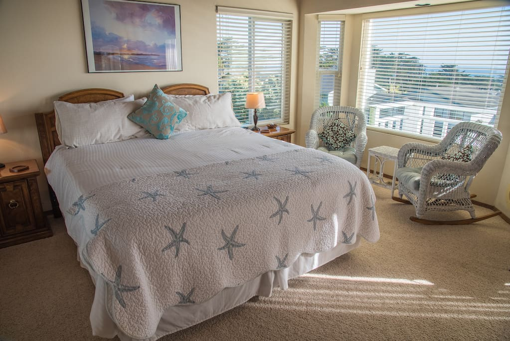 Master bedroom provides a California king-size bed and access to a private balcony