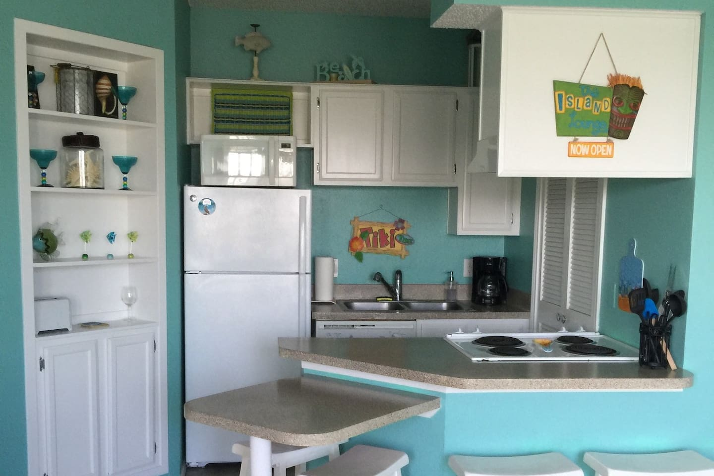 Kitchen with fridge, dishwasher, microwave, stove, oven, full sized washer and dryer