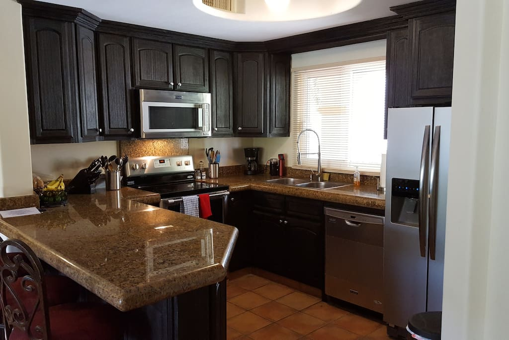 Fully equipped kitchen with new ss appliances, granite countertops.
