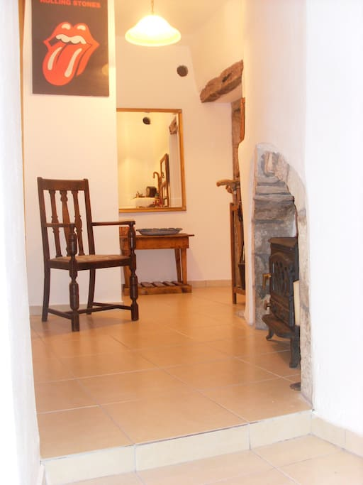 Hallway leading to the stairs for the kitchen, dining room and sitting room.