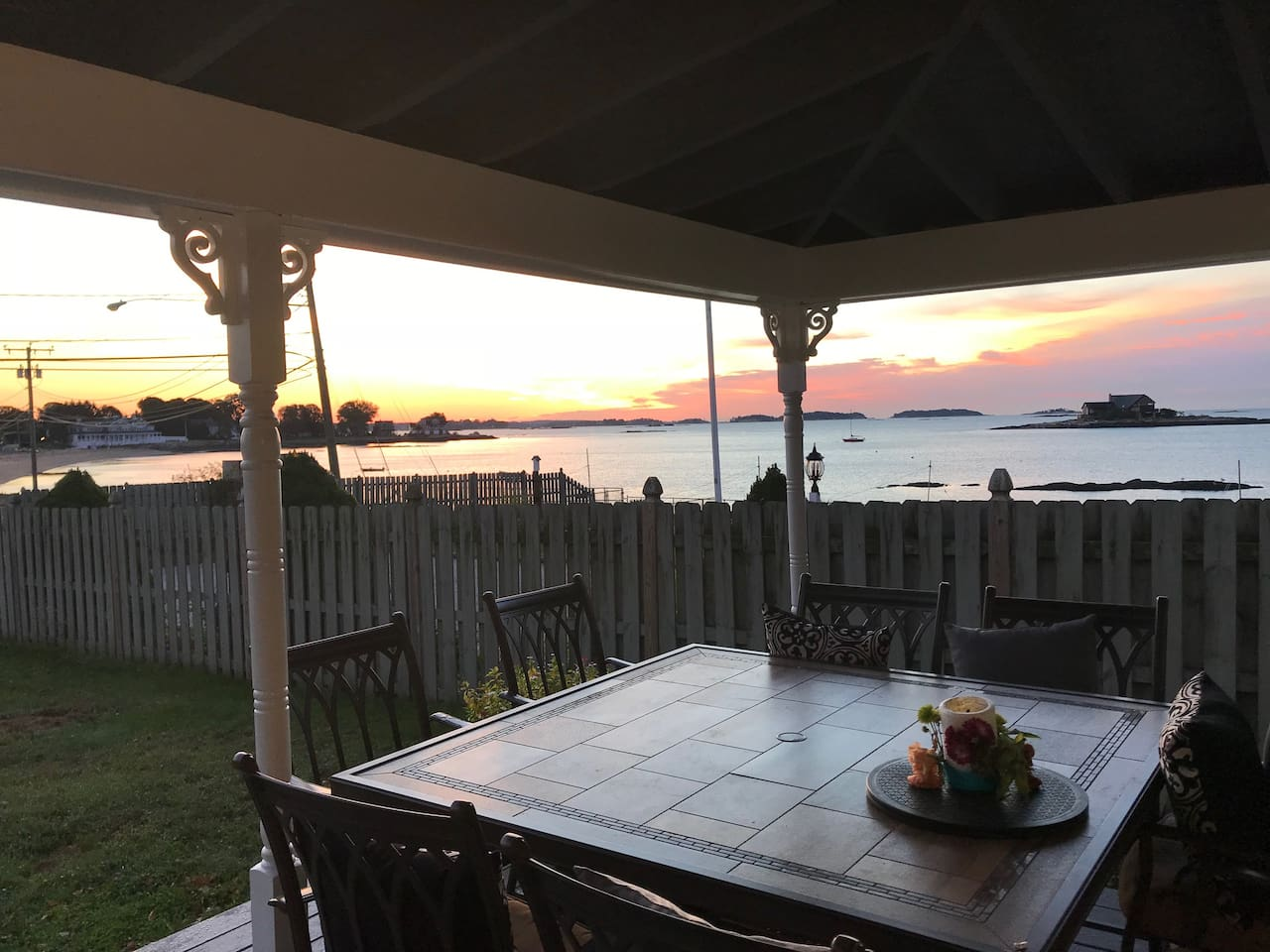 """Spectacular sunrise from the front porch with views of the Long Island Sound and the """"Green Island."""""""