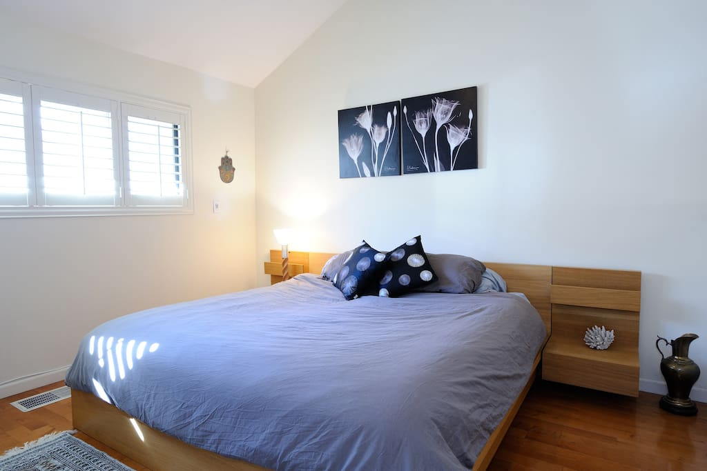 King sized bed with darkening shutters
