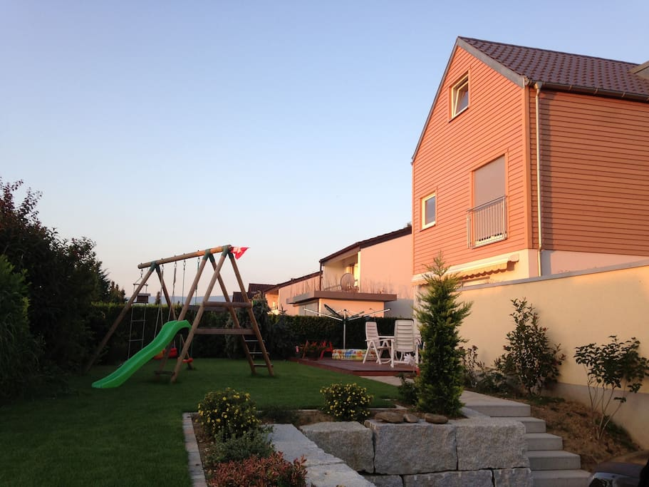 Our home with garden, wooden terrace and lots and lots of sun
