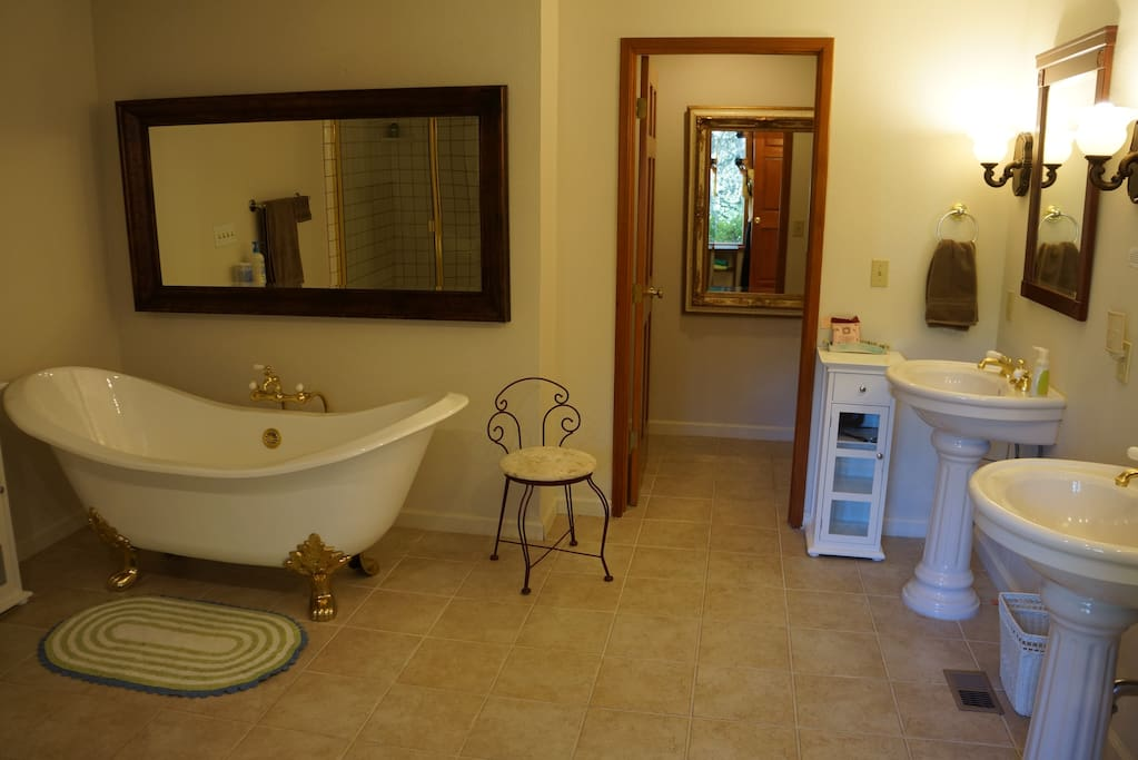 Room 1's deluxe bathroom boasts a claw foot bathtub for two, a large shower, a private toilet room, and two sinks.