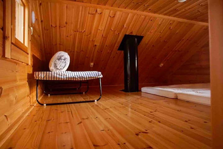 There are two sleeping places on the alcove in the sauna.