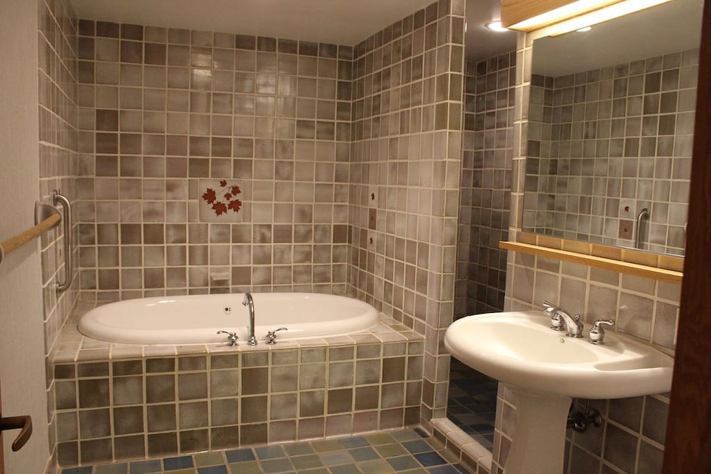 Each guest room has a large whirlpool bathtub and separate shower