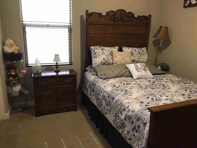 2nd bedroom with closet and drawer space for your items.