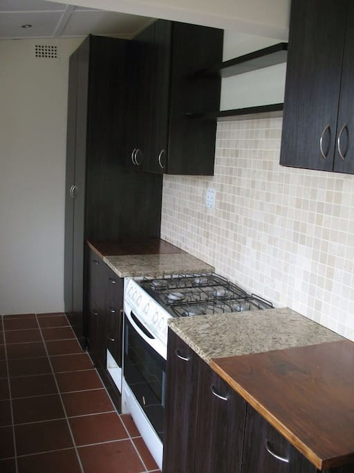 Opposite Kitchen Counter with Stove - Microwave will be included on request