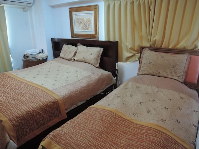 Twin bed room with share bath room and toilet
