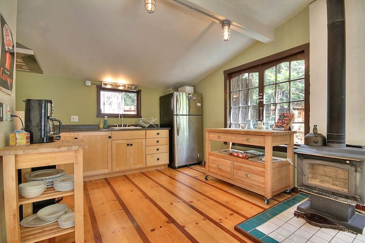 here's the kitchen, and the wood burning stove.  microwave and coffee maker are waiting for you.