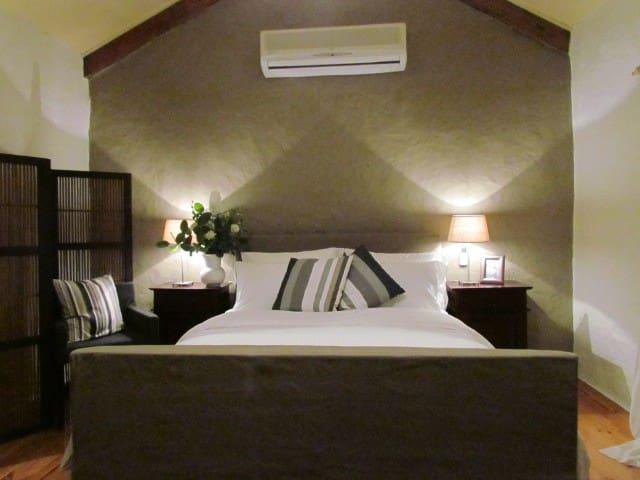 The simple sophistication of the main bedroom