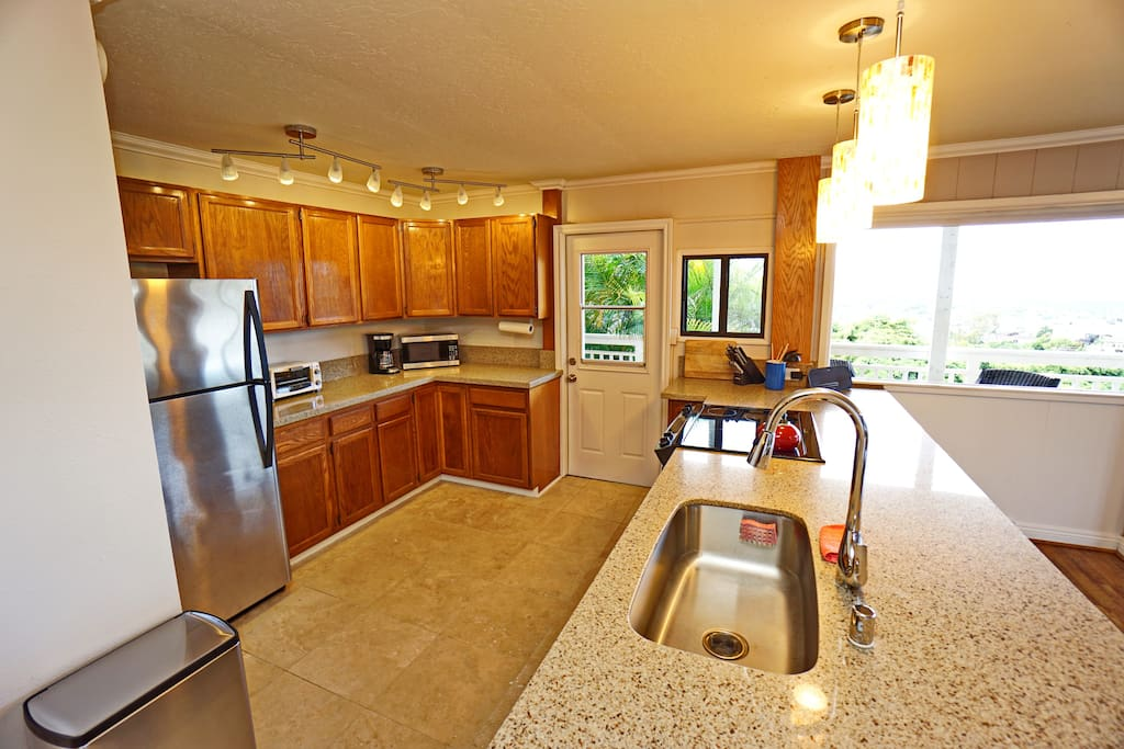 Large open kitchen with every tool and dish imaginable.