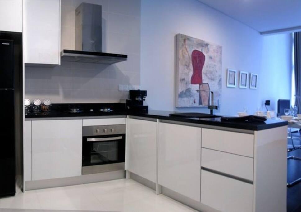 Full kitchen & fridge with plates, utensils