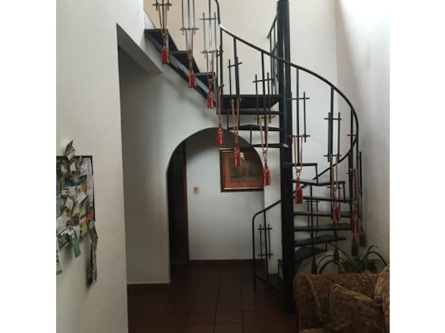 The spiral staircase leading to the SHARED TV / game lounge