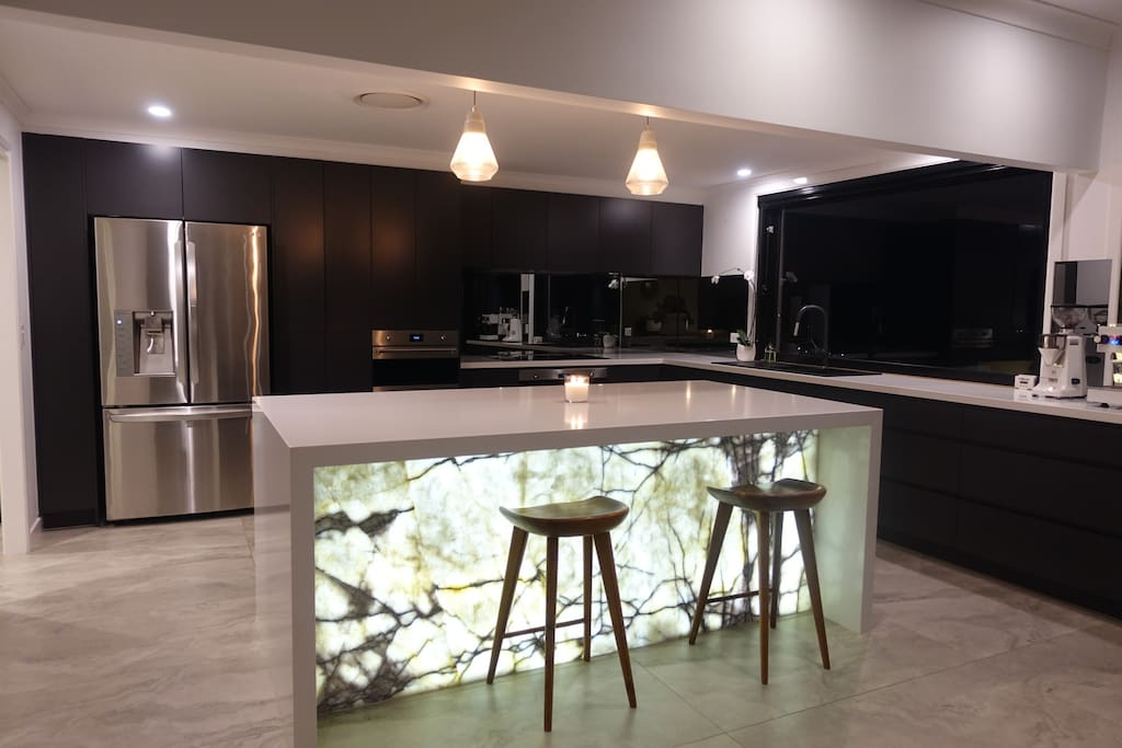 Brand-new gourmet kitchen with sensational back-lit marble island