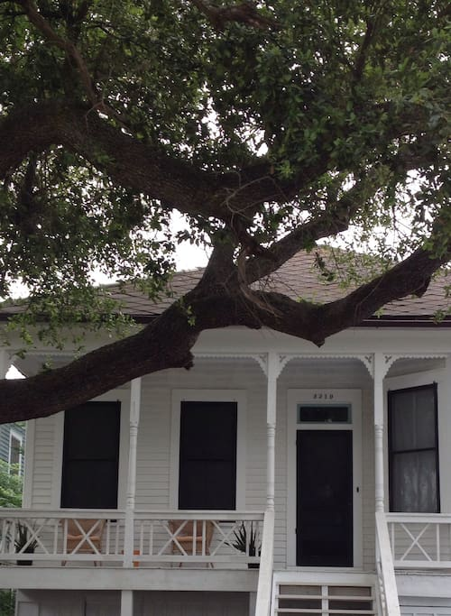 Front porch seating shaded by 100 year old live oak. Great place for morning coffee.