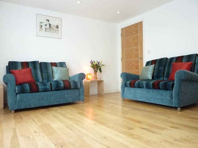 Converted in 2010, with lovely light interiors, real oak flooring and comfy sofas