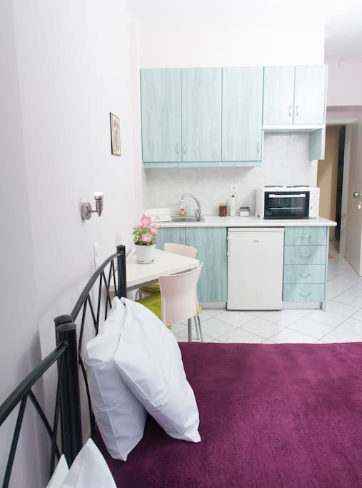 Interior view-fully equipped kitchen and the table(1st studio)