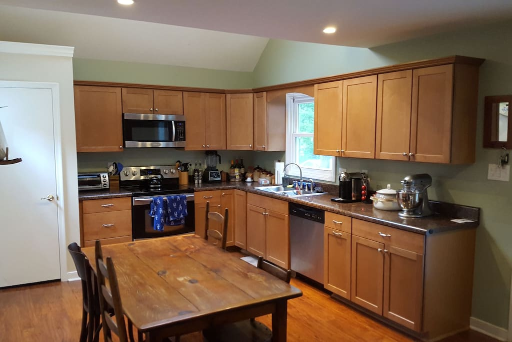 this is a picture of the other half of the kitchen. We have lots of utensils and amenities for cooking, such as the kitchen aid mixer and vitamix blender.