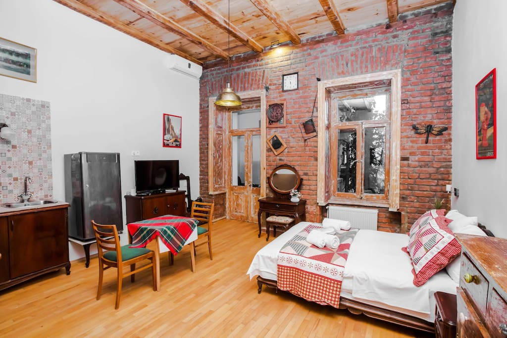 Brick wall and wooden ceiling create very homey atmosphere