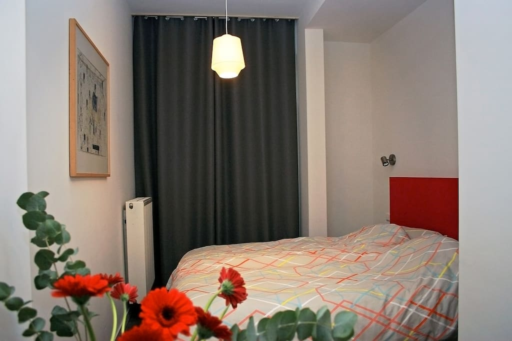 The 'red' room is an attractive, quiet double bedroom, decorated with art and design.