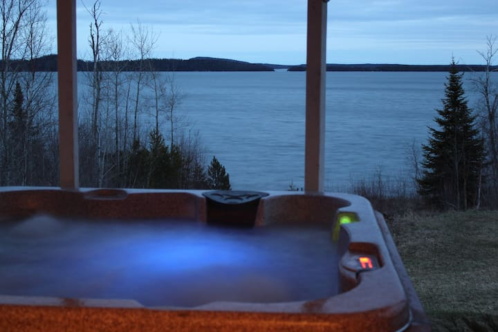 View from the master bedroom door to the hot tub and the fantastic view of Lake Superior at dusk.