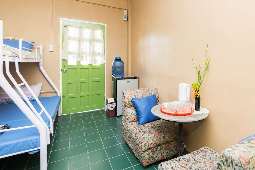 This spacious room has a large bathroom and a sitting nook.
