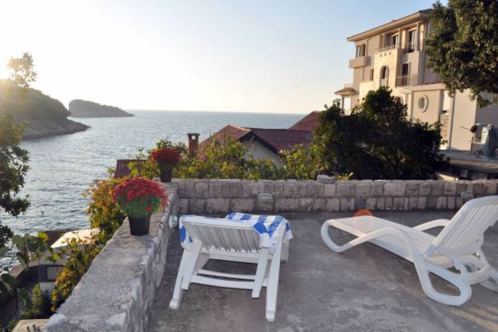 large terrace 50m2 with a garden overlooking the sea, from which we observe spectacular sunsets, is located in front of the house to which you coming down with large covered terrace, which is part of the house.
